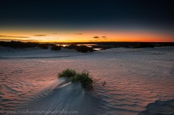 Sun setting over the sand dunes