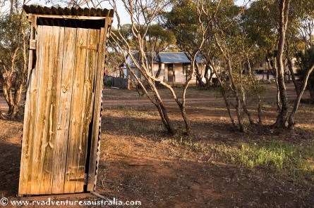 The old outside toilet with a bit of a lean to it.